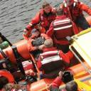 The casualty is brought ashore